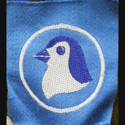 insigne tissu inconnu tête de pingouin sur fond bleu et cercle blanc