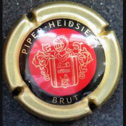 Capsule Muselet de bouteille de champagne Piper Heidsieck rouge et or