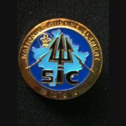 TRANS : insigne des transmissions SIC national support élément (NSE) de la brigade de commandement et de soutien (BCS), 6° Mandat, au Kosovo opération trident
