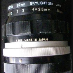 OBJECTIF NIKKOR-O AUTO 1:2 F à 35 mm & FILTRE HOYA 52 mm SKY (1B)