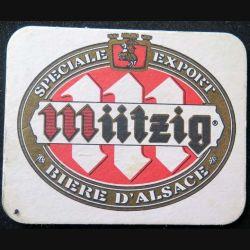 DESSOUS DE VERRE A BIÈRE : Dessous de verre à bière Mützig spéciale export de dimension 9,9  X 7,8 cm