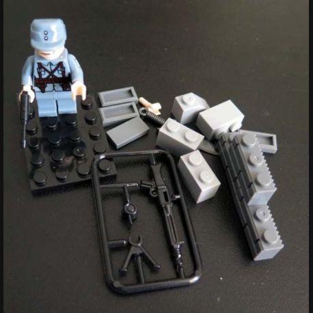 Pochette comprenant 1 personnage soldat chinois avec accessoires divers