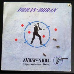 DISQUE 45 TOURS : Duran-Duran A view to a kill dangereusement votre(C177)