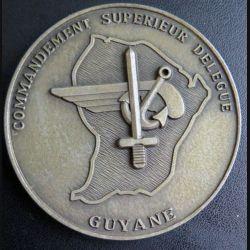 COMSUP GUYANE : plaque du commandement supérieur délégué de  Guyane en métal argenté de diamètre 74 mm